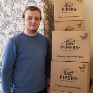 Libertas Volunteer Sam Ryder With Donation Of Crisps From Pipers